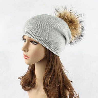 Knitted Hat With Natural Raccoon Pompom on home page